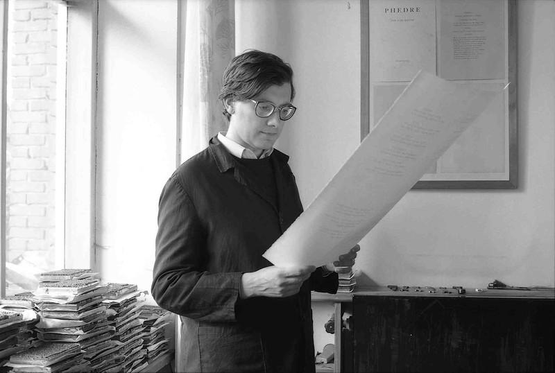 Alpignano, 1980s. Aldo Tallone (1951-1991) checks a printed sheet.