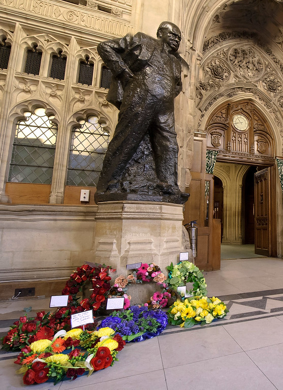 . Floral tributes are placed at a statue of Sir Winston Churchill in Westminster Hall on January 30, 2015 in London, England. The service marks a day of tributes to Sir Winston Churchill commemorating the 50th Anniversary Of his state funeral.  (Photo by Jessica Taylor - Pool /Getty Images)