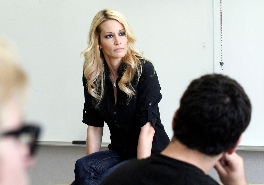 """. Jessica Drake, Sex Educator and Adult Film Star, listens to a student ask a question about being in the porn industry during Professor Hugo Schwyzer\'s \""""Navigating Pornography\"""" class at Pasadena City College, in Pasadena, Wednesday, March 20, 2013. (Correspondent Photo by James Carbone/SXCITY)"""