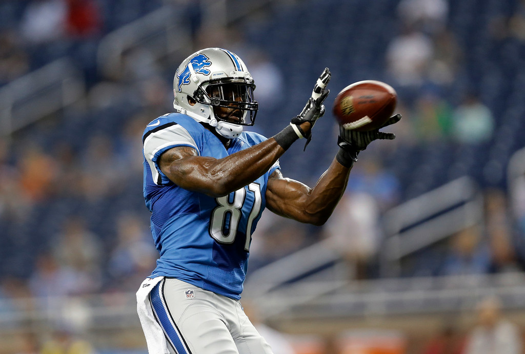 . Detroit Lions wide receiver Calvin Johnson (81) catches a ball during warmups for a NFL football game against the Jacksonville Jaguars in Detroit, Friday, Aug. 22, 2014.  (AP Photo/Paul Sancya)