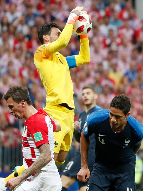 . France goalkeeper Hugo Lloris blocks a shot during the final match between France and Croatia at the 2018 soccer World Cup in the Luzhniki Stadium in Moscow, Russia, Sunday, July 15, 2018. (AP Photo/Natacha Pisarenko)