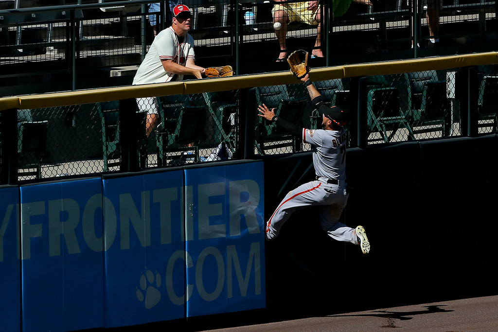 . DENVER, CO - SEPTEMBER 3:  Left fielder Gregor Blanco #7 of the San Francisco Giants makes a leaping effort but is unsuccessful in his attempt to catch a three run home run off the bat of Nolan Arenado (not pictured) of the Colorado Rockies during the fifth inning at Coors Field on September 3, 2014 in Denver, Colorado. (Photo by Justin Edmonds/Getty Images)