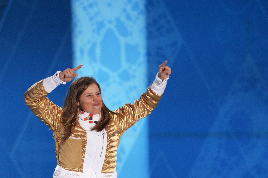 . Czech Republic\'s gold medalist Eva Samkova celebrates during the Women\'s Snowboard Cross Medal Ceremony at the Sochi medals plaza during the Sochi Winter Olympics on February 16, 2014.  ANDREJ ISAKOVIC/AFP/Getty Images