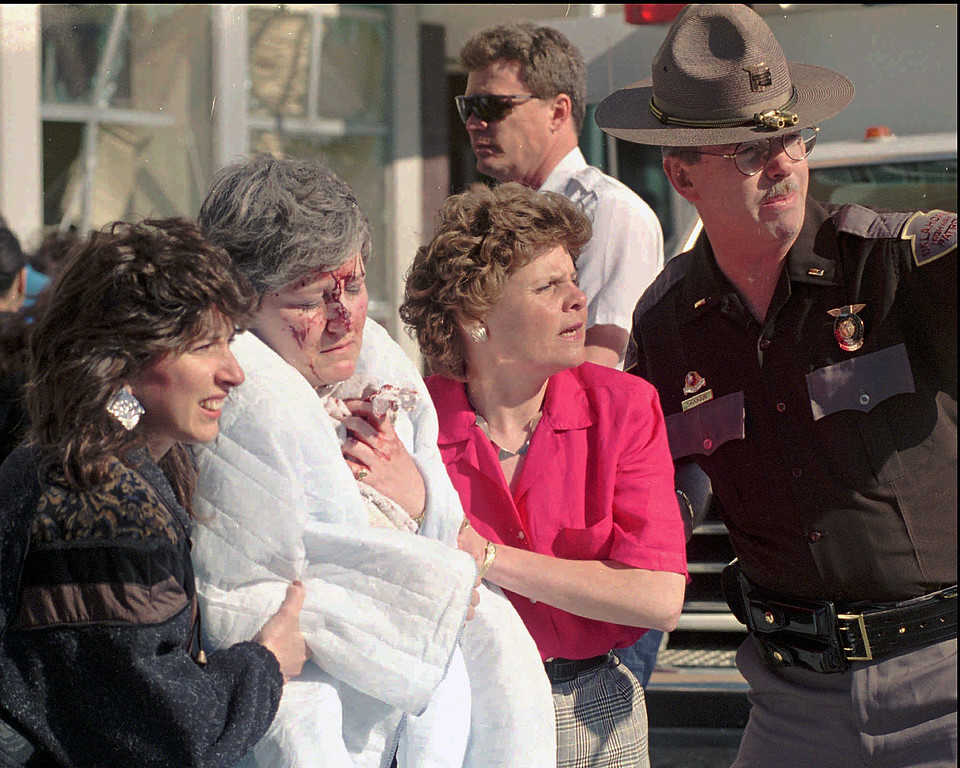 . FILE - In this April 19, 1995 file photo, a victim of the explosion that ripped a nine-story hole in the the Alfred Murrah Federal Building Wednesday, April 19, 1995, in downtown Oklahoma City, is helped from the scene. The blast killed 168 people - including 19 children - injured hundreds more and caused hundreds of millions of dollars in damage to structures and vehicles in the downtown area. (AP Photo/J. Pat Carter)
