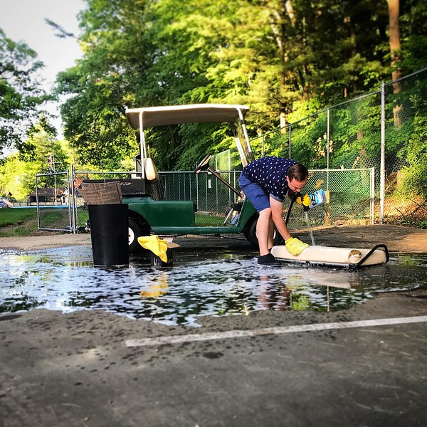 Cleaning a golf cart to be used as a miniature golf course prop