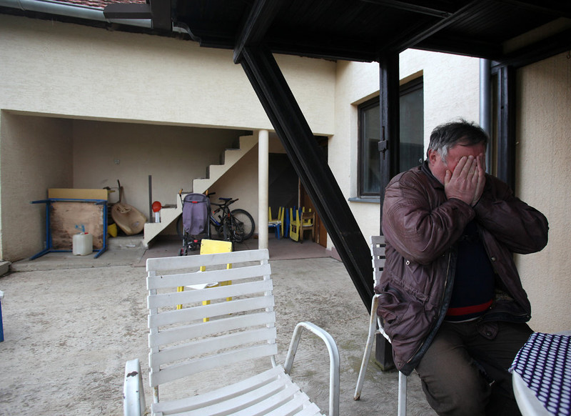 . Radmilo Bogdanovic, brother of Ljubisa Bogdanovic cries in village of Velika Ivanca, Serbia, Tuesday, April 9, 2013. Ljubisa Bogdanovic a 60-year-old man gunned down 13 people, including a baby, in a house-to-house rampage in a quiet village on Tuesday before trying to kill himself and his wife, police and hospital officials said. Belgrade emergency hospital spokeswoman Nada Macura said the man, identified as Ljubisa Bogdanovic  used a handgun in the shooting spree at five houses. The dead included six women. (AP Photo/Darko Vojinovic)