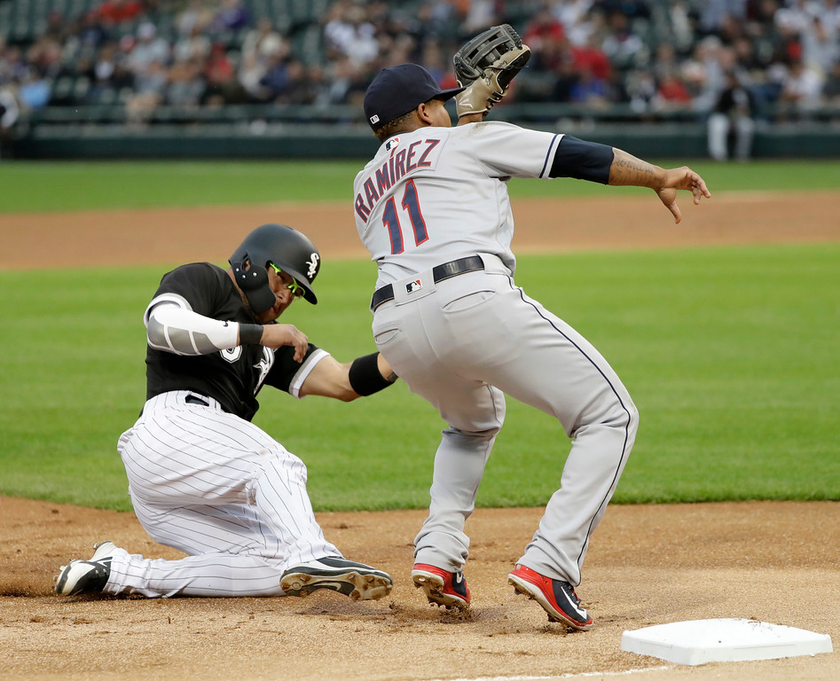 . Chicago White Sox\'s Yolmer Sanchez steals third as Cleveland Indians third baseman Jose Ramirez waits for the throw from catcher Yan Gomes during the first inning of a baseball game Monday, June 11, 2018, in Chicago. (AP Photo/Charles Rex Arbogast)