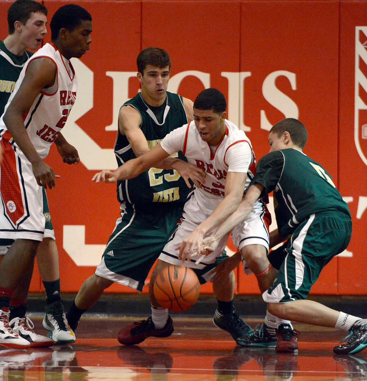 . LITTLETON, CO. - JANUARY 29: Regis Josh Perkins (3) gets double teamed by  Mountain Vista Graham Smith (25) and Damani Respass (0) during their game January 29, 2013 at Regis.  (Photo By John Leyba / The Denver Post)