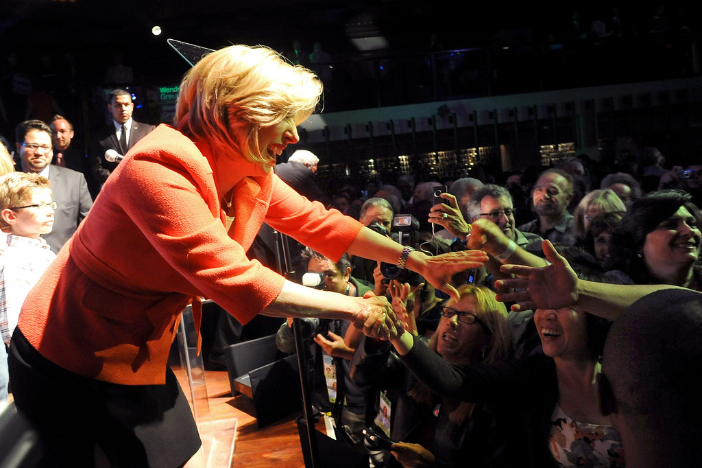 . Wendy Greuel shakes hands with supporters after speaking during her election night party at the Exchange in Los Angeles, CA May 21, 2013.(Andy Holzman/Staff Photographer)