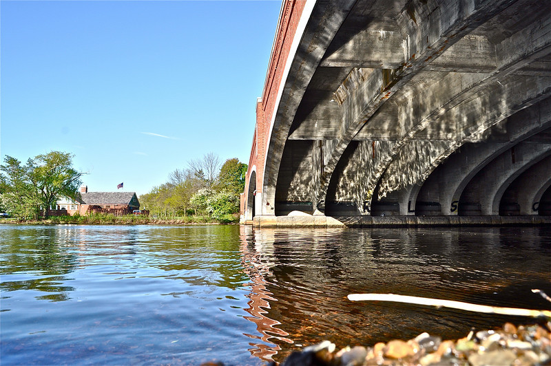 Water reflecting on the underbelly of the Eliot Bridge in Cambridge MA.