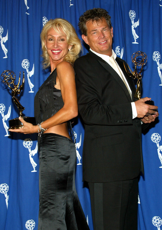 ". LOS ANGELES - SEPTEMBER 13:  Award winners Linda Thompson (L) and David Foster arrive in the press room at the 2003 Primetime Creative Emmy Awards with their Emmy for Oustanding Music and Lyrics ""For Concert World Children\"" at the Shrine Auditorium on September 13, 2003 in Los Angeles, California.  (Photo by Frederick M. Brown/Getty Images)"