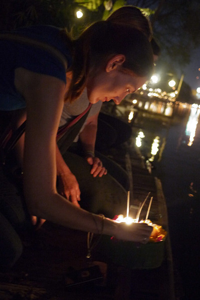 Preparing to release a krathong during Loy Krathong in Chiang Mai, Thailand