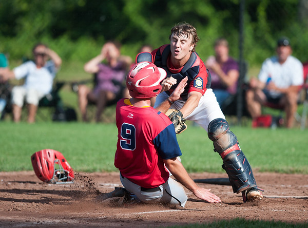 07/24/18 Wesley Bunnell | Staff Berlin Legion baseball vs Moosup on Tuesday afternoon at Sage Park. Ryan Hyde (3) applies the tag on the throw from pitcher Camden Murphy (2). to nab the Moosup runner Michael Bates (9).