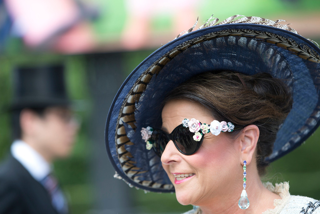 . Vickie Wilson wears an ornate pair of sunglasses on the second day of the Royal Ascot horse racing meeting at Ascot, England,  Wednesday, June, 18, 2014.  (AP Photo/Alastair Grant)