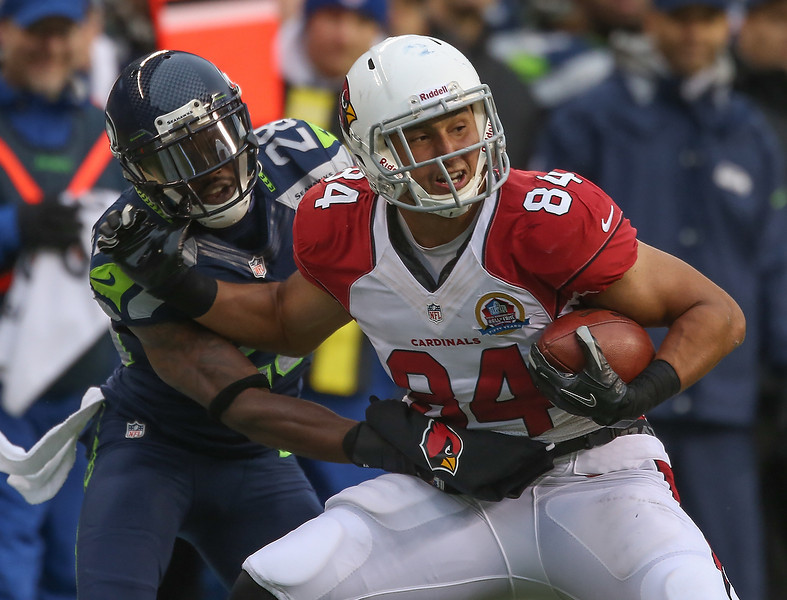 . Tight end Rob Housler #84 of the Arizona Cardinals is tackled by cornerback Walter Thurmond #28 of the Seattle Seahawks at CenturyLink Field on December 9, 2012 in Seattle, Washington. The Seahawks defeated the Cardinals 58-0.  (Photo by Otto Greule Jr/Getty Images)