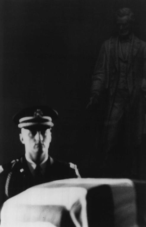 . An honor guard keeps watch over the casket. Associated Press file