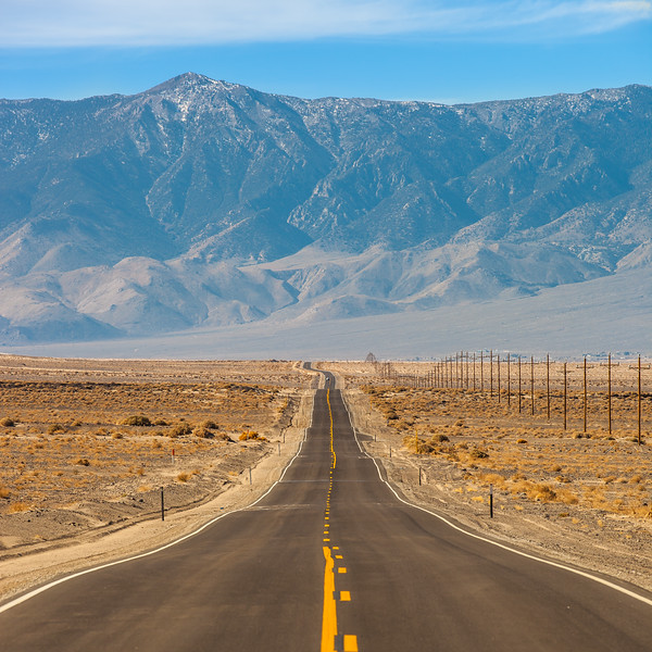 Long straight highway in the foothills of Sierra Nevada mountains