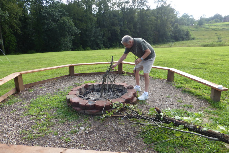 Dad preparing the wood for the fire.