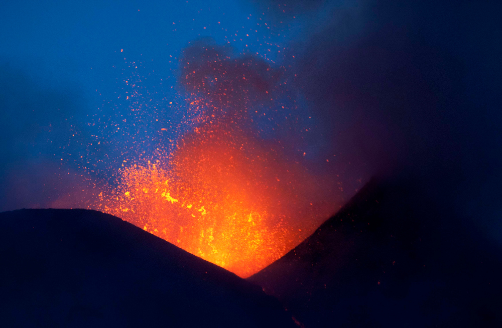 Description of . Italy's volcanic Mount Etna spews lava during an eruption on the southern Italian island of Sicily April 11, 2013. Mount Etna is Europe's tallest and most active volcano. Picture taken April 11, 2013. REUTERS/Antonio Parrinello