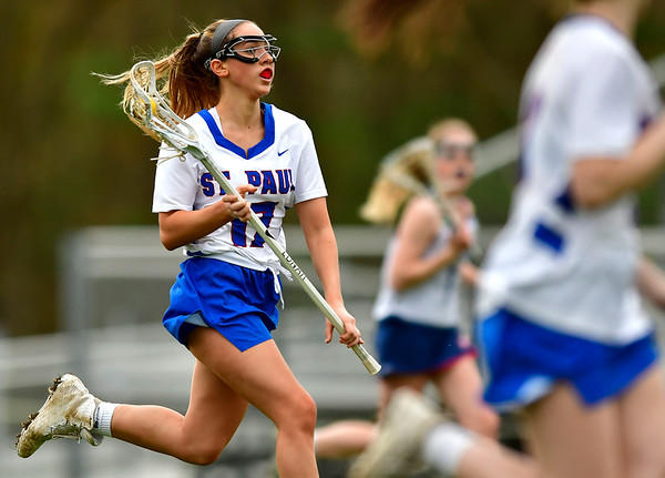 5/2/2019 Mike Orazzi | Staff St. Paul's Madison Farrell (17) during Thursday's girls lacrosse with Amistad in Bristol.