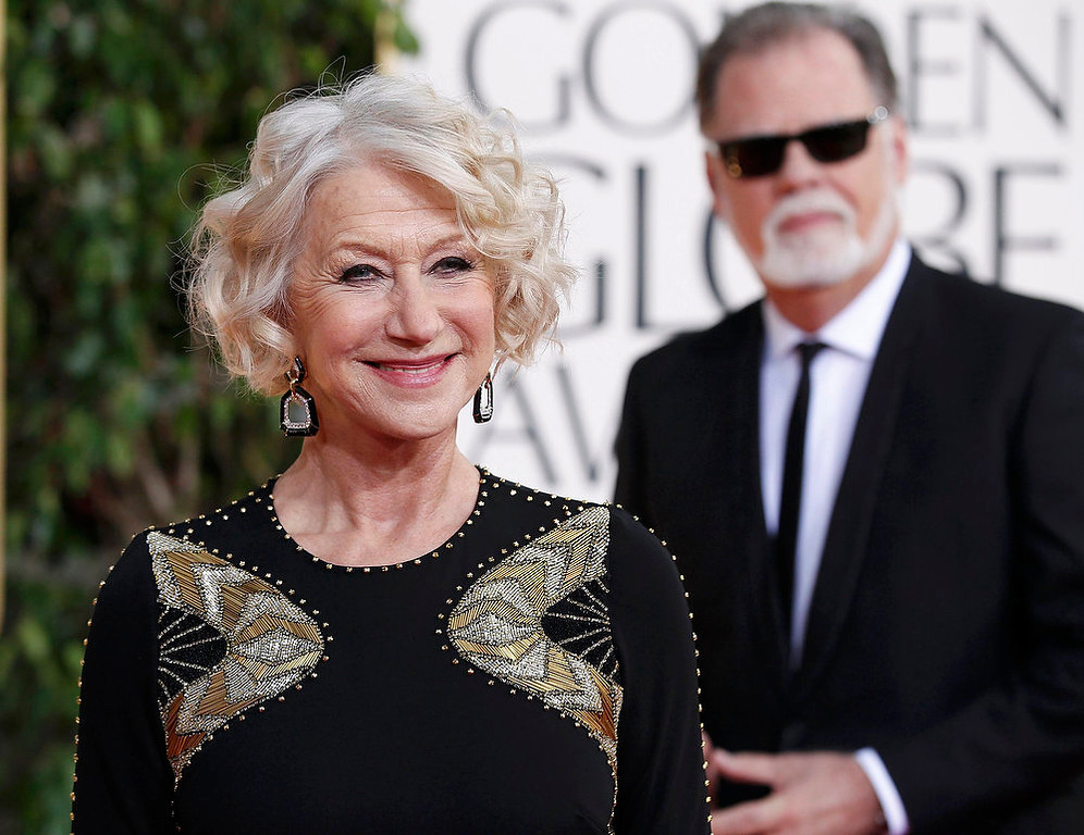 . Actress Helen Mirren and director Taylor Hackford arrive at the 70th annual Golden Globe Awards in Beverly Hills, California, January 13, 2013.  REUTERS/Mario Anzuoni