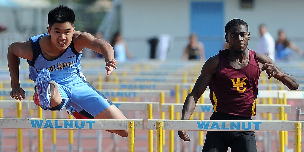 . Walnut\'s Alan Tantiwassadakran, left, finishes first ahead of West Covina\'s Josh Taylor in the 110 hurdles during the Hacienda League track finals in Walnut, Calif., on Thursday, May 8, 2014.  (Keith Birmingham Pasadena Star-News)
