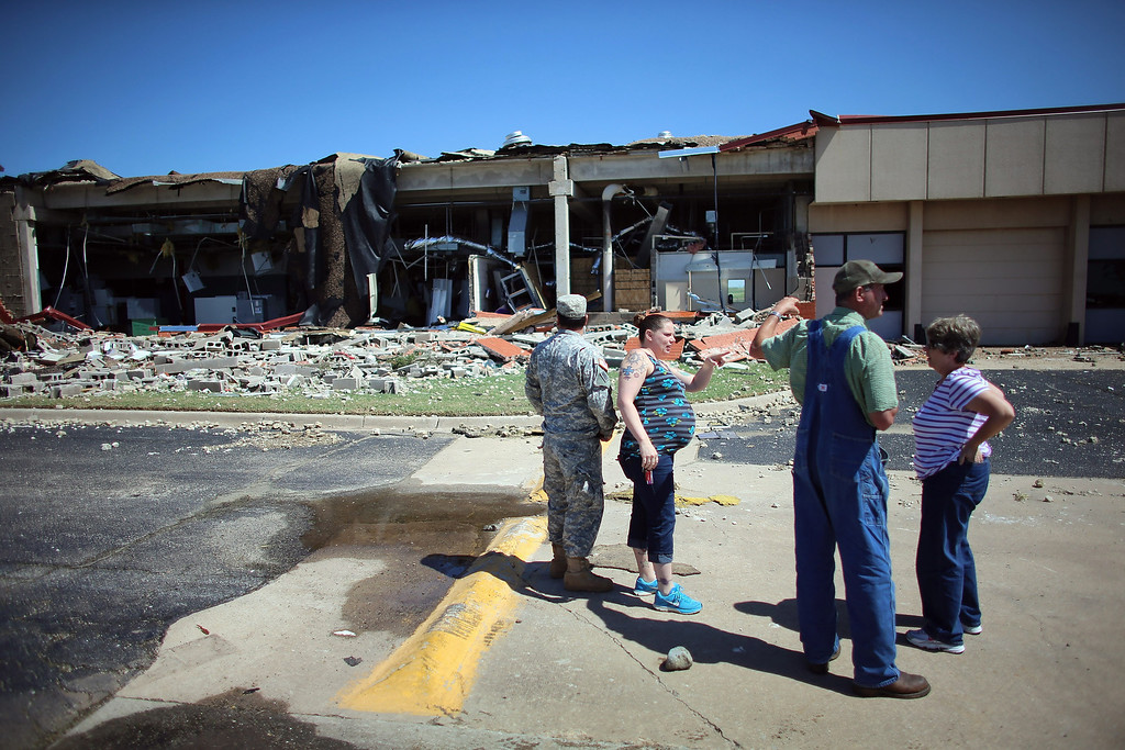 . EL RENO, OK - JUNE 01:  People survey the damage at the at Canadian Valley Technology Center\'s El Reno Campus after it was hit by a powerful tornado on June 1, 2013 in El Reno, Oklahoma. The tornado ripped through the area killing at least nine people, injuring many others and destroying homes and buildings.  (Photo by Joe Raedle/Getty Images)