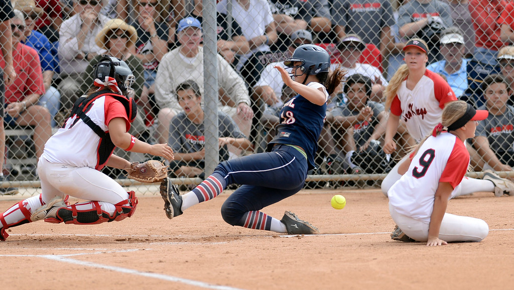 . Palos Verdes catcher Allison Benitez (17) tries to get to the ball as St. Paul\'s Sydney Kreimann (18) slides in safely in a CIF-SS Division III semifinal softball game Tuesday, May 27, 2014, Palos Verdes Estates, CA.  Palos Verdes lost 10-0. Photo by Steve McCrank/Daily Breeze