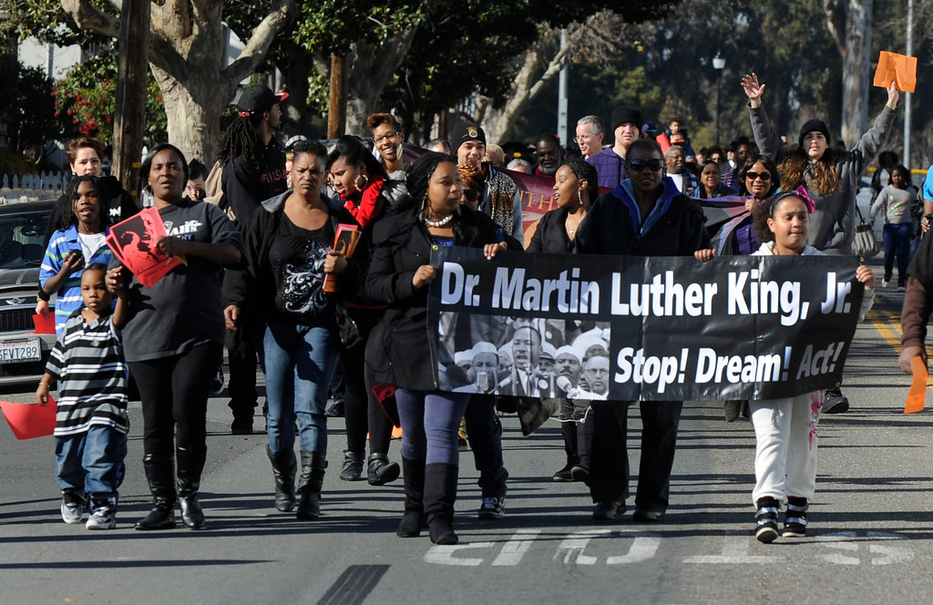 . People walk down School Street on their way to the Creative Arts Building for a special event to honor Martin Luther King Jr. in Pittsburg, Calif., on Monday, Jan. 21, 2013. Olympic bronze medalist John Carlos, who raised a fist in a controversial human rights salute during the 1968 Olympics, was the keynote speaker at the event. (Susan Tripp Pollard/Staff)