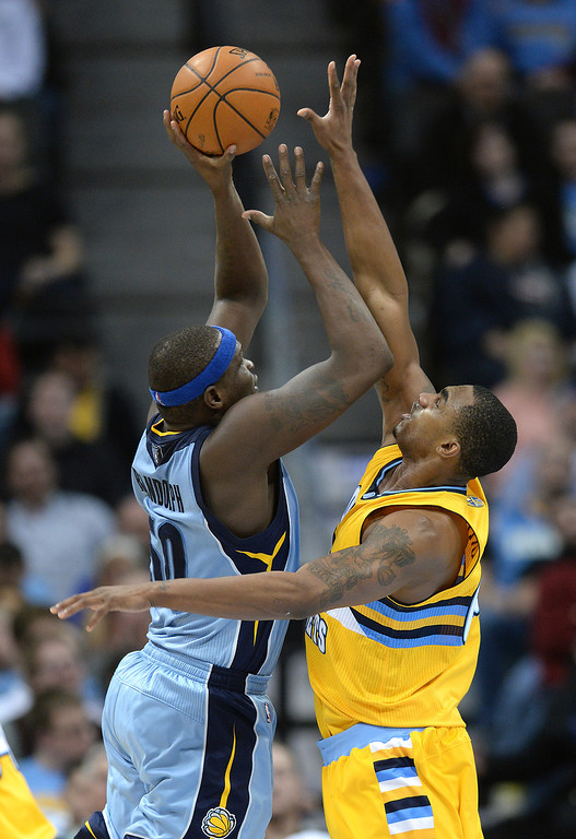 . DENVER, CO. - JANUARY 03:  Denver forward Darrell Arthur (00) tried to stop Memphis forward Zach Randolph (50) on the way to the hoop in the second half. The Denver Nuggets broke an eight-game losing streak with a 111-108 win over the Memphis Grizzlies at the Pepsi Center Friday night, January 3, 2014. Photo By Karl Gehring/The Denver Post