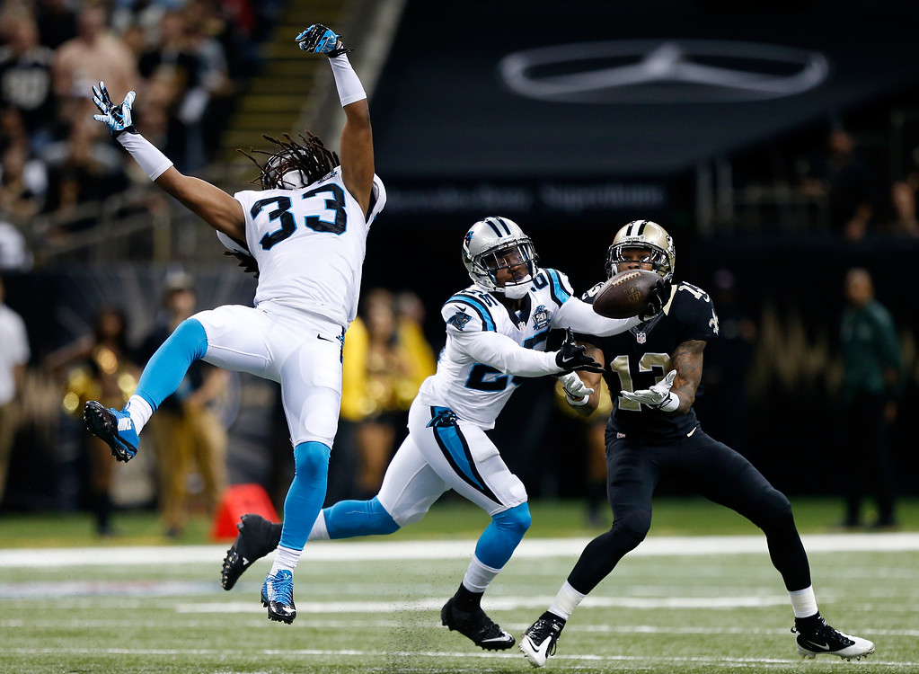 . NEW ORLEANS, LA - DECEMBER 07:  Bene\' Benwikere #25 of the Carolina Panthers intercepts a pass intended for  Joseph Morgan #13 of the New Orleans Saints during the first quarter at Mercedes-Benz Superdome on December 7, 2014 in New Orleans, Louisiana.  (Photo by Sean Gardner/Getty Images)