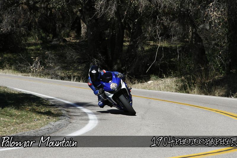 A suzuki GSX-R motorcycle Rider heads down south grade road on Palomar Mountain.
