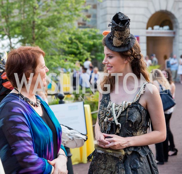 "Angela Haseltine Pozzi, Lead Artist and Executive Director of Washed Ashore, ""Trashion"" model Nerea Fuentes. Photo by Erin Schaff. 2016. Washed Ashore: Art to Save the Sea VIP Reception. Smithsonian National Zoo Elephant Community Center. May 26, 2016."