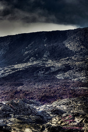 Processing boosted up a bit extra to really show the contrast between the pahoehoe lava (the smooth liquid-y stuff in the foreground and all the silver-y streaks throughout). The black and purples are 'a'a lava, which is rougher and sharp textured. © 2012 Sugar + Shake