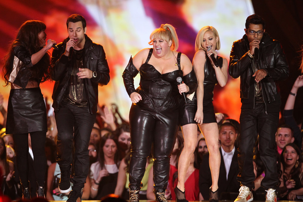 ". Host Rebel Wilson and the cast of ""Pitch Perfect\"" perform onstage at the MTV Movie Awards in Sony Pictures Studio Lot in Culver City, Calif., on Sunday April 14, 2013. (Photo by Matt Sayles/Invision /AP)"