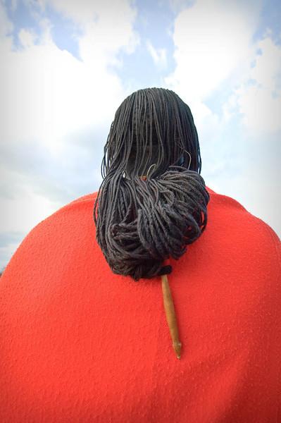 Back of Emmanuel's head - he is wearing his kind of wig worn by Masai men