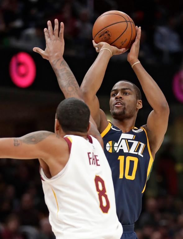 . Utah Jazz\'s Alec Burks (10) shoots against Cleveland Cavaliers\' Channing Frye (8) in the first half of an NBA basketball game, Saturday, Dec. 16, 2017, in Cleveland. (AP Photo/Tony Dejak)