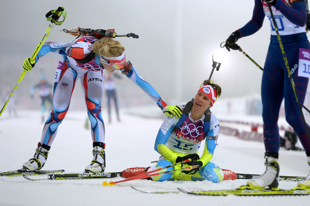 . Teja Gregorin (C) of Slovenia collapses at the finish line in the Women\'s 10 km Pursuit during day four of the Sochi 2014 Winter Olympics at Laura Cross-country Ski & Biathlon Center on February 11, 2014 in Sochi, Russia.  (Photo by Harry How/Getty Images)