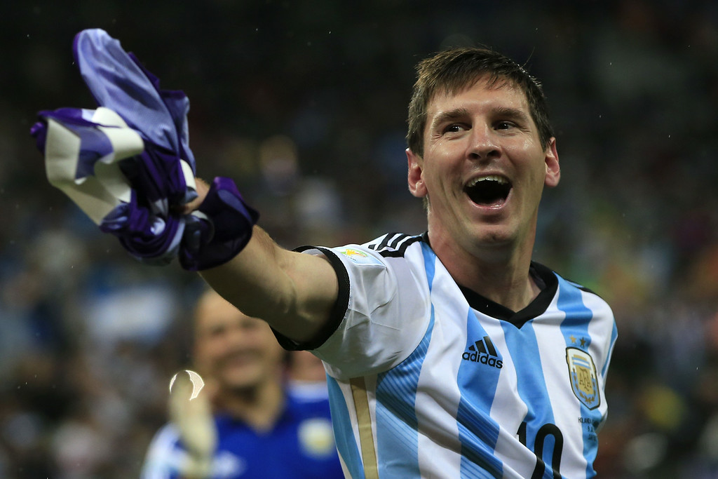 . Argentina\'s forward and captain Lionel Messi celebrates his team\'s victory at the end of the semi-final football match between Netherlands and Argentina of the FIFA World Cup at The Corinthians Arena in Sao Paulo on July 9, 2014. Argentina won 4-2 on penalties.   ADRIAN DENNIS/AFP/Getty Images