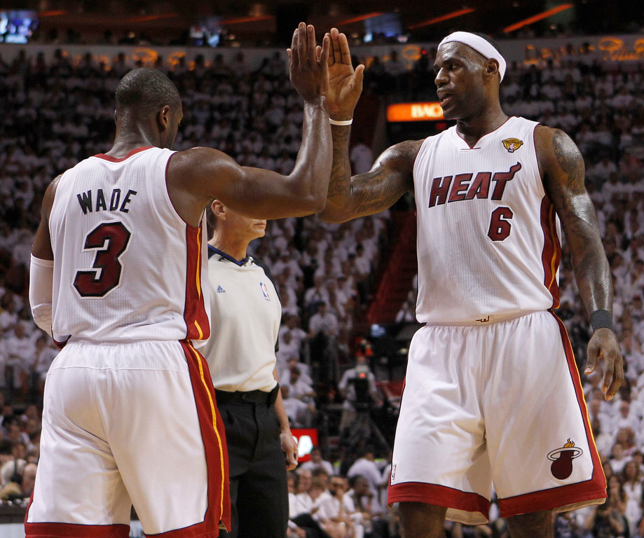 . Miami Heat\'s Dwyane Wade (3) is congratulated by Lebron James (6) after Wade was fouled during the first half of Game 1 of the NBA Finals basketball game against the Dallas Mavericks, Tuesday, May 31, 2011, in Miami. (AP Photo/Lynne Sladky)