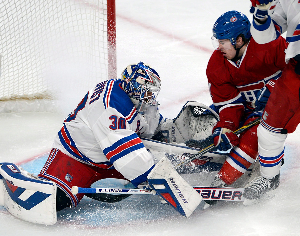 . Montreal Canadiens right wing Brendan Gallagher (11) is stopped by New York Rangers goalie Henrik Lundqvist (30) during the first period in Game 1 of the Eastern Conference finals in the NHL hockey Stanley Cup playoffs in Montreal on Saturday, May 17, 2014. (AP Photo/The Canadian Press, Ryan Remiorz)