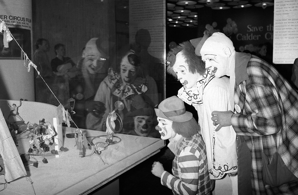 . Clowns from Ringling Bros. and Barnum and Baily Circus admire artist Alexander Calder�s sculpture titled �The Circus� at New York�s Whitney Museum of American Art, April 16, 1982. The museum has begun a fund drive to raise $1.25 million in six weeks to keep the sculpture that the artist�s estate plans to sell. Producers of Ringling Bros. and Barnum and Baily Circus have agreed to help with the campaign. (AP Photo/David Pickoff)