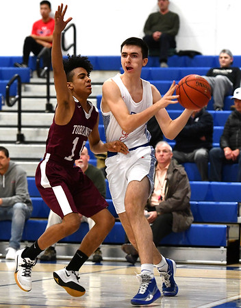 2/4/2020 Mike Orazzi | StaffrSt. Paul's Will Barton (3) and Torrington's Elian Pena (15) during Tuesday night's boys basketball game with Torrington in Bristol.