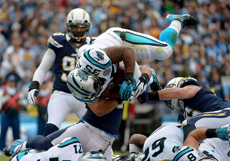 . Mike Tolbert #35 of the Carolina Panthers dives for a touchdown against the San Diego Chargers on December 16, 2012 at Qualcomm Stadium in San Diego, California. (Photo by Donald Miralle/Getty Images)