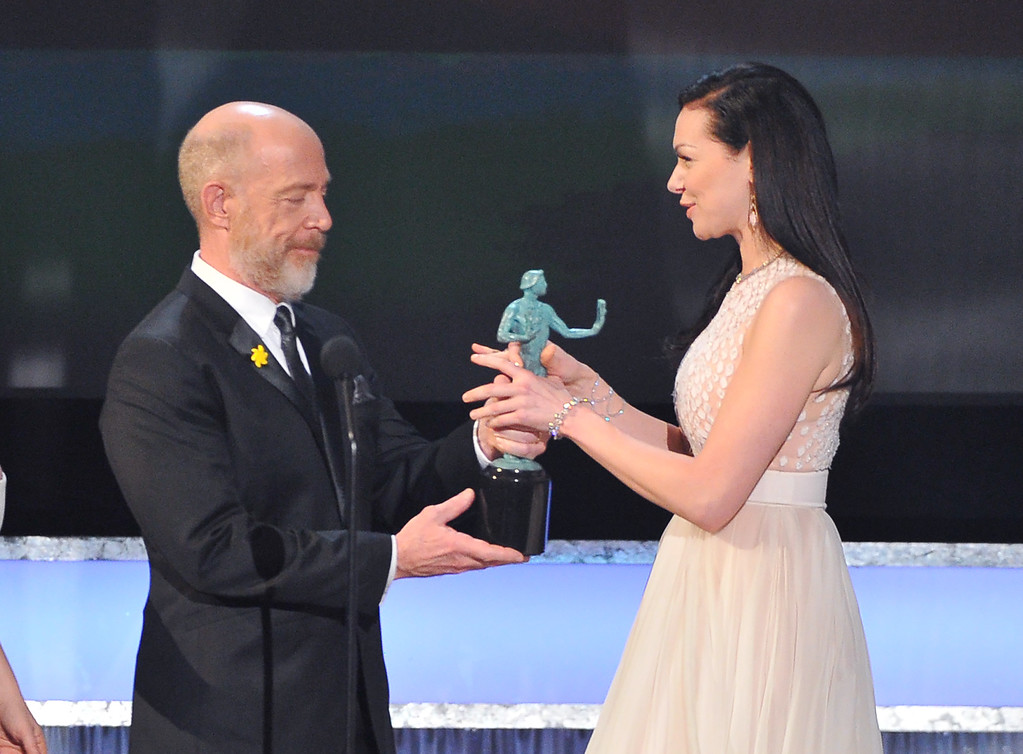 . J.K. Simmons, left, presents Laura Prepon with the award for outstanding ensemble in a comedy series for ìOrange is the New Blackî at the 22nd annual Screen Actors Guild Awards at the Shrine Auditorium & Expo Hall on Saturday, Jan. 30, 2016, in Los Angeles. (Photo by Vince Bucci/Invision/AP)