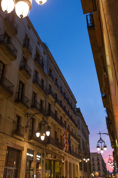 Sunset in Barcelona with cool street lights.