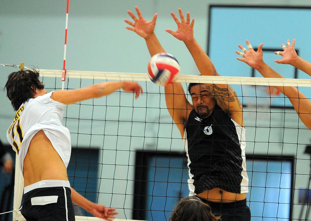 . CARSON - 04/09/2013  (Photo: Scott Varley, Los Angeles Newspaper Group)  San Pedro vs Carson boys volleyball. Carson won 3-0. Carson\'s Pu\'e Togia blocks a hit at the net by San Pedro\'s Jacob Branch.