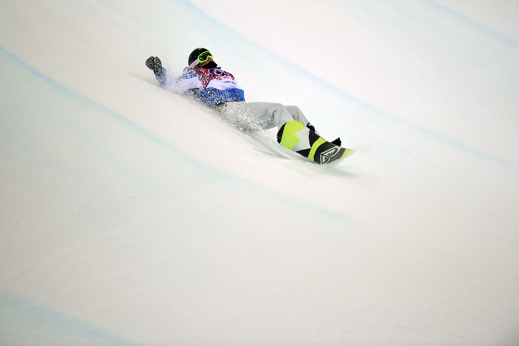 . France\'s Clemence Grimal falls while competing in the Women\'s Snowboard Halfpipe Semifinals at the Rosa Khutor Extreme Park during the Sochi Winter Olympics on February 12, 2014.  AFP PHOTO / JAVIER  SORIANO/AFP/Getty Images
