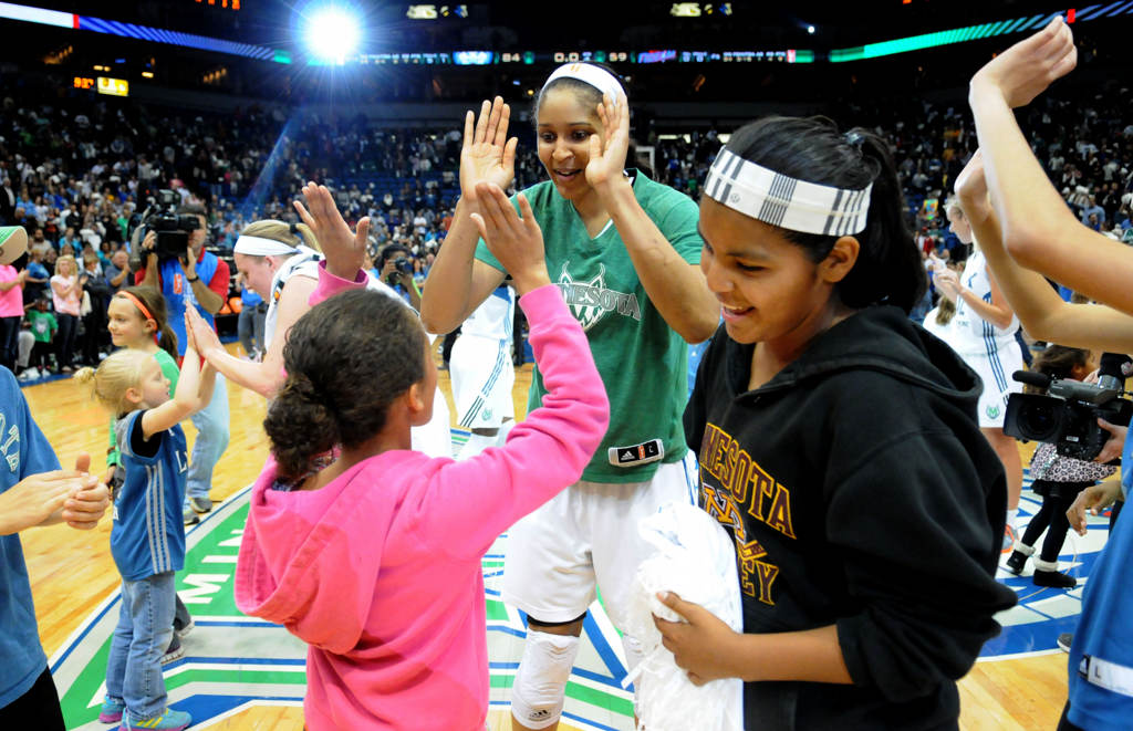 . Maya Moore high-fives kids after dancing with them center court after the Lynx\'s 84-59 win over the Atlanta Dream. (Pioneer Press: Sherri LaRose-Chiglo)