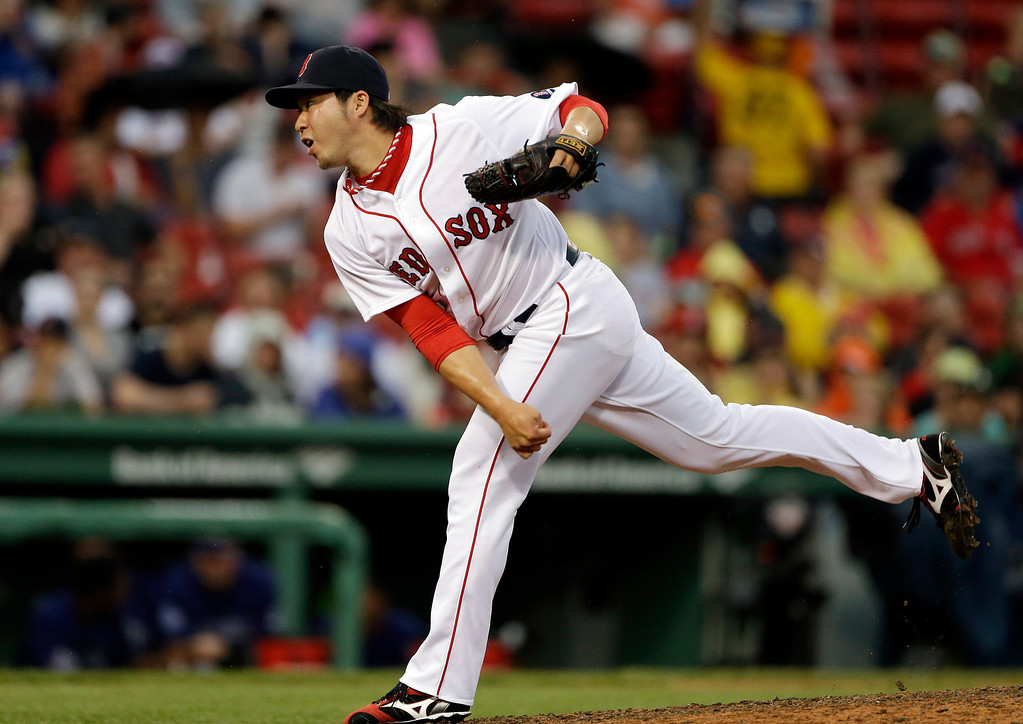 . Boston Red Sox relief pitcher Junichi Tazawa delivers to the Colorado Rockies during the eighth inning of an interleague baseball game at Fenway Park in Boston, Wednesday, June 26, 2013. The Red Sox won 5-3. (AP Photo/Elise Amendola)